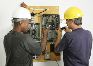 image of electrical guys working on panel